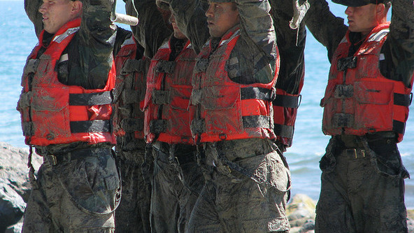 Navy Seal candidates all sandy and happy