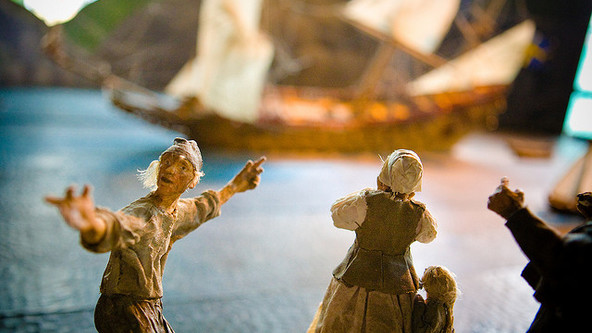 paper mache dolls pointing to ship