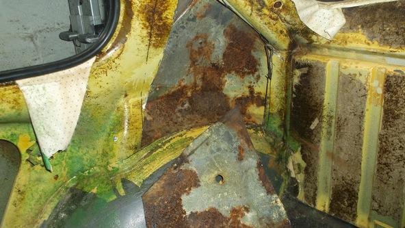 A photo of rust inside C-Pillar